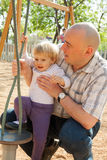 Girl with dad on  playground. Stock Photo