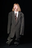 Girl in Dad's Business Suit Stock Photo