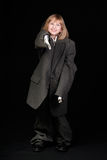 Girl in Dad's Business Suit pointing Royalty Free Stock Photos
