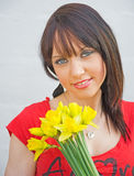 Girl with daffodils. Stock Image