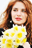 Girl with daffodils Royalty Free Stock Images