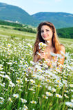 Girl with daisies Royalty Free Stock Photos
