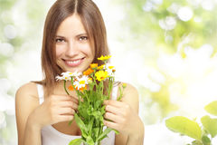 Girl with daisies Stock Images