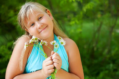 A girl with daisies Stock Image