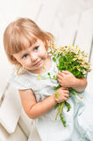 Girl with daisies Royalty Free Stock Image