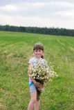 Girl with daisies Royalty Free Stock Photography