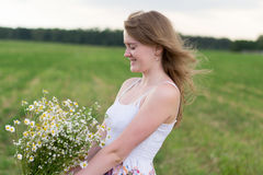 Girl with daisies Stock Photography