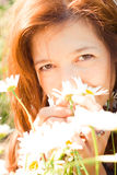 Girl in daisies Royalty Free Stock Image