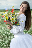 Girl with daisy bouquet Stock Images