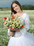 Girl with daisy bouquet Royalty Free Stock Photos