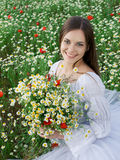 Girl with daisy bouquet Stock Image