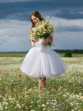 Girl in daisy field. Young happy girl with bouquet in daisy field Royalty Free Stock Photos