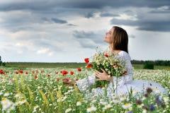 Girl in daisy field Royalty Free Stock Photo
