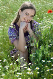 Girl in daisy field Royalty Free Stock Images