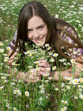 Girl in daisy field Royalty Free Stock Photography