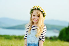 Girl in daisy field Stock Image