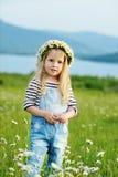 Girl in daisy field Stock Photo