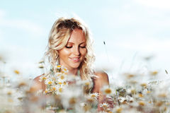 Girl on the daisy flowers field Stock Photography