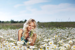 Girl on the daisy flowers field Royalty Free Stock Images