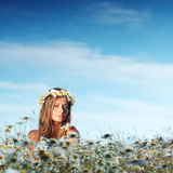 Girl on the daisy flowers field Stock Photo