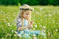 Girl with daisy Royalty Free Stock Photo