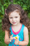 Girl with daisy in her hands Royalty Free Stock Photos