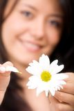 Girl with daisy - loves me not Stock Photos