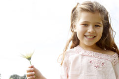 Girl with daisy in park. Stock Photography