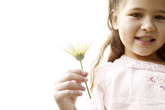 Girl with daisy in park. Royalty Free Stock Photos