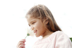 Girl with daisy in park. Royalty Free Stock Photo