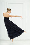 Girl in dance. Girl in a black dress moves nicely in dance royalty free stock photography