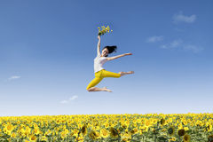 Girl dance over yellow sunflowers Royalty Free Stock Photos