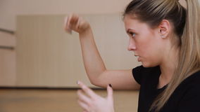 Girl dancer demonstrates the movements of the arms. stock footage