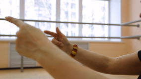 Girl dancer demonstrates the movements of the arms. Close up stock video