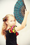 Girl dancer with a fan Royalty Free Stock Photo