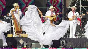 A girl dancer performs folkloric dance from Veracruz wearing a beautiful regional typical dress as part of the cultural activities. Mexico City, Mex. 01/12/2018 stock footage