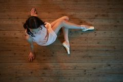 Girl dancer sitting on  floor view from above Stock Images