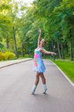 Girl dancer stands on tiptoes, ballet pirouette. Outdoors, spring Royalty Free Stock Images
