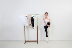 Girl dancer before Training. Choose Your clothes. Ballerina stock image