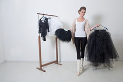 Girl dancer before Training. Choose Your clothes. Ballerina royalty free stock photo