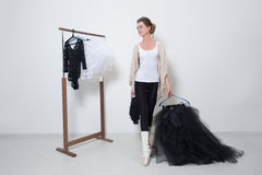 Girl dancer before Training. Choose Your clothes. Ballerina royalty free stock image