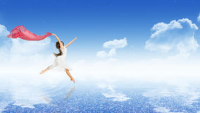 Girl dancer on water surface Stock Image