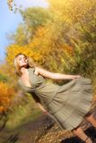 Girl dances in the autumn forest Stock Image