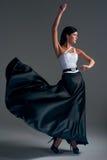 Girl dances in a black skirt Stock Image