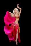 Girl dances east dance. Black background Stock Photos