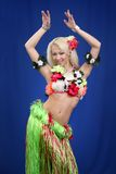 Girl dances exotic dance. Dark blue background Stock Image