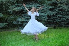 Girl in dances with lifted hands Royalty Free Stock Photos