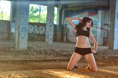 Girl dancing in the abandoned room Royalty Free Stock Photo