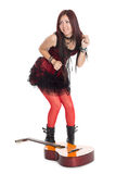 Girl dancing around with the guitar Royalty Free Stock Photos