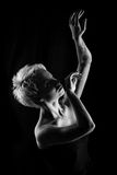 Girl dancing. Attractive girl dancing, filmed in black and white version Stock Photo